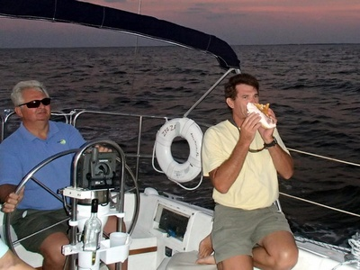 Captain Ed Blowing Conch Horn to honor Sunset